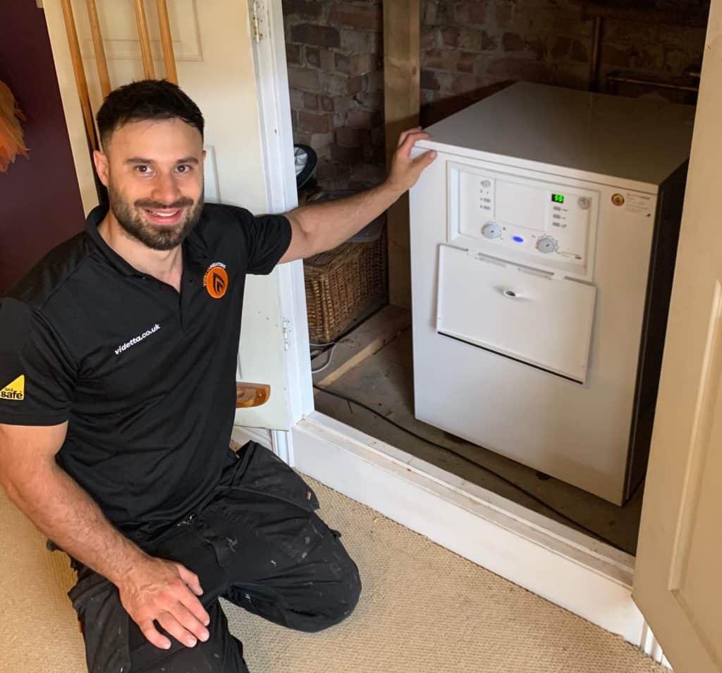 Jordan Videtta plumber installing new Worcester Bosch boiler